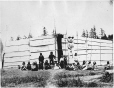 West Coast aboriginal house and totem pole, BC, about 1885 (MP-0000.343.1)